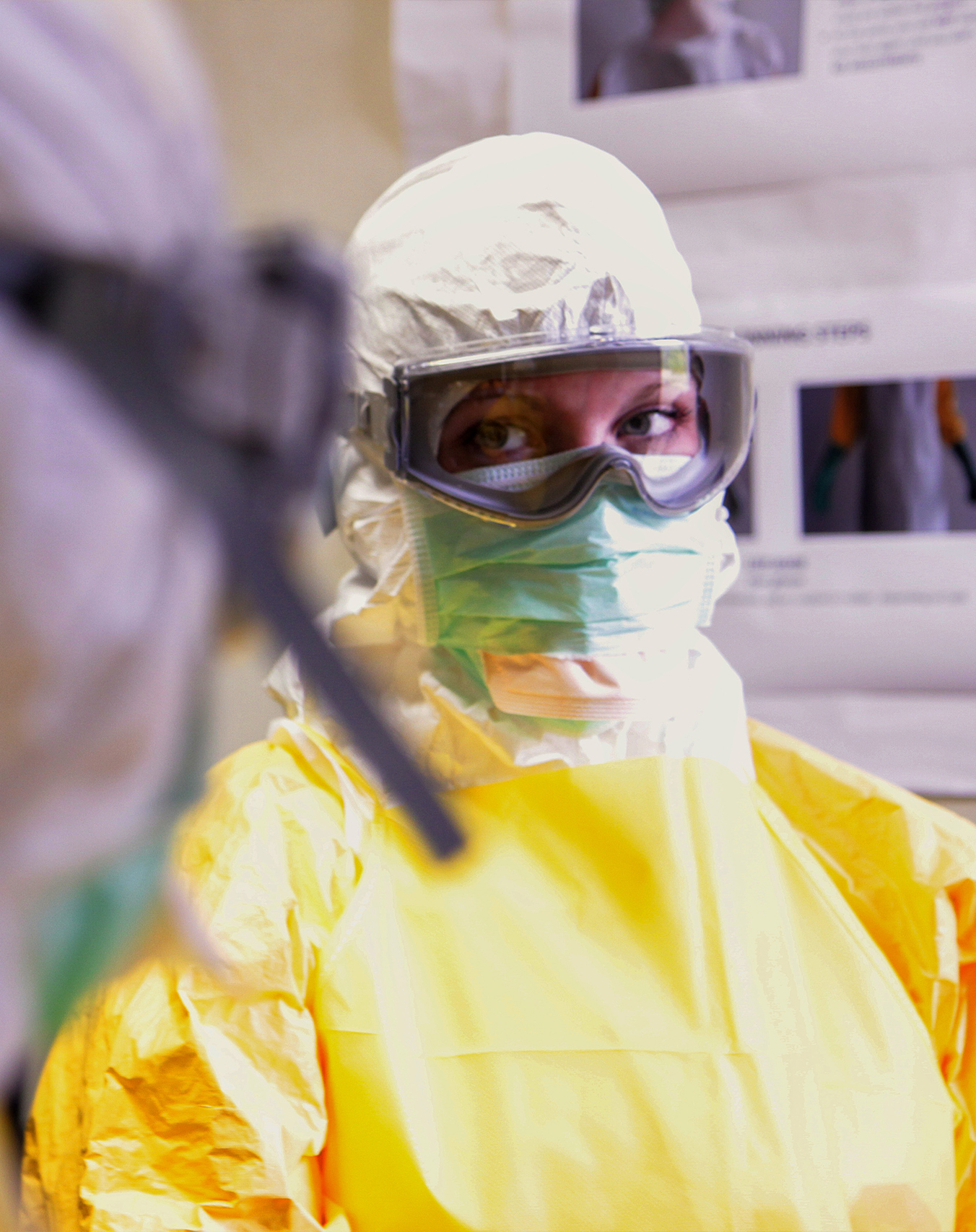 Coronavirus Pandemic. A disinfector in a protective suit and mask sprays disinfectants in the room.